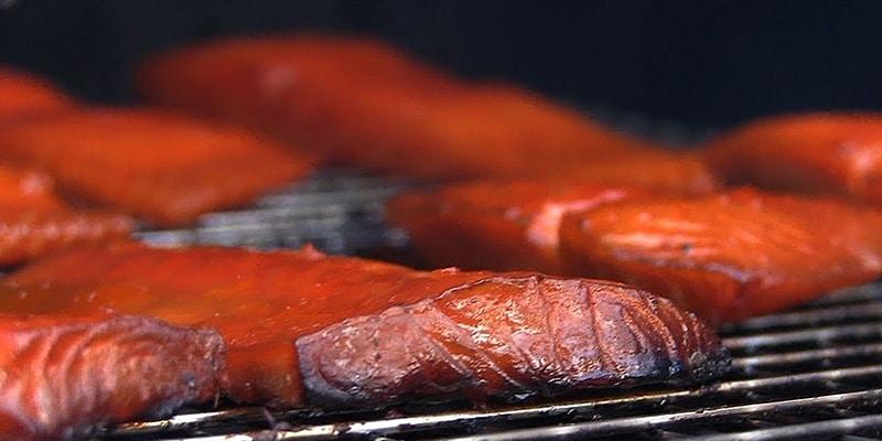 smoking salmon on a grill