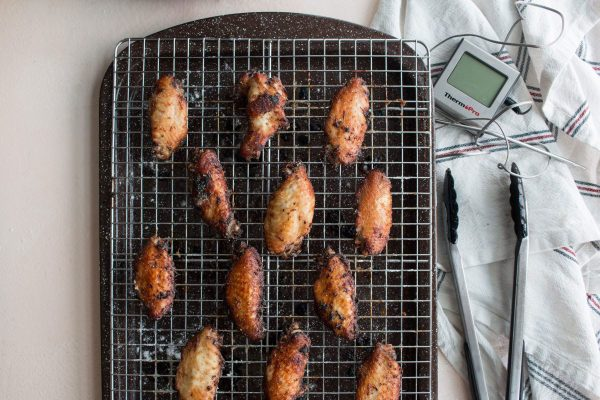 spread sauce on the prepared chicken wings