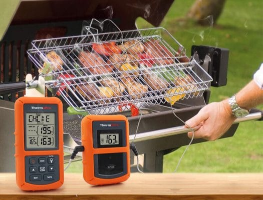 smoke grilling with food thermometer